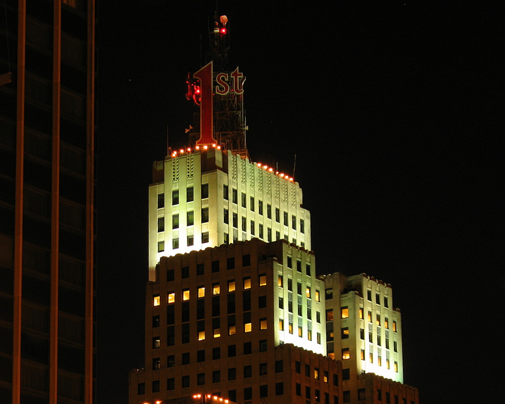 Nighttime view of the First National Bank building in downtown St Paul.