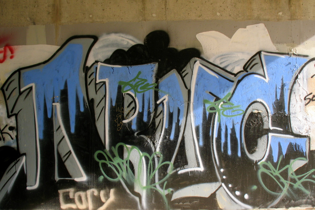 More graffiti under the Highway 61 bridge in St Paul.