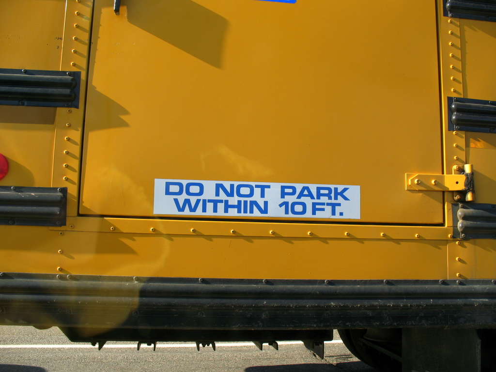 A warning sticker on a school bus, do not park within 10 feet.