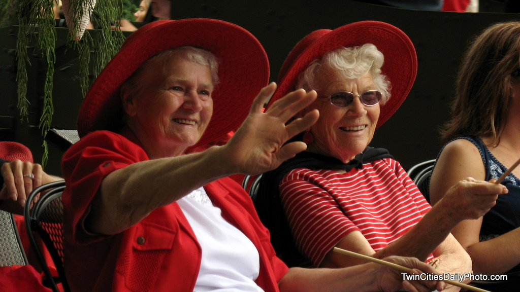 A couple of smiles from two ladies with red hats that were involved in the Afton, 4th of July parade. I captured them as they passed along the route.