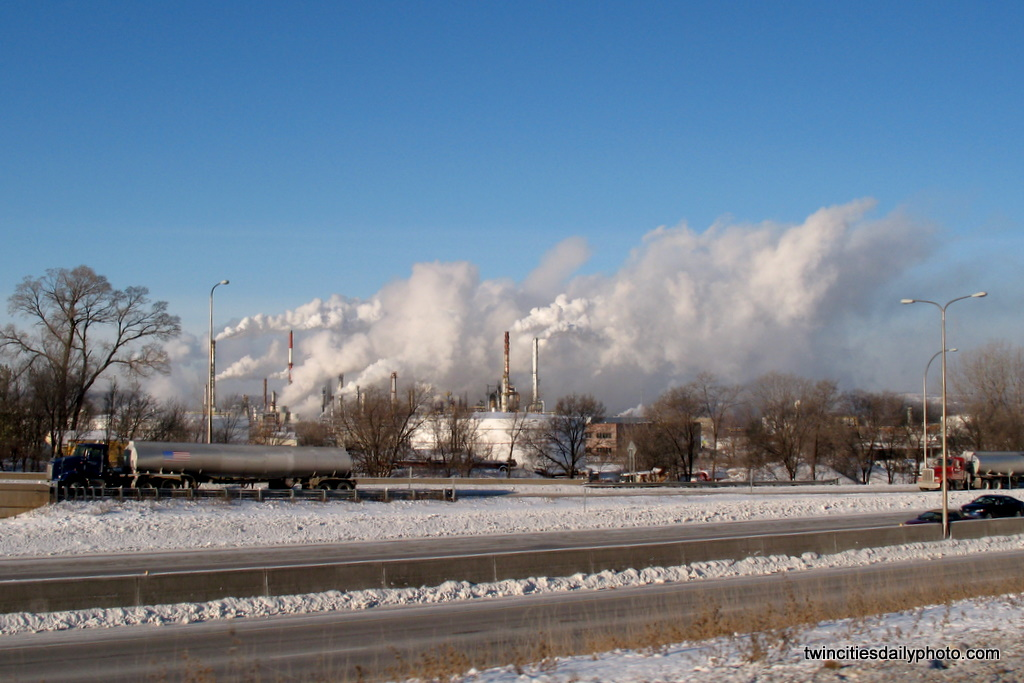 The Ashland Oil Refinery was throwing off steam everywhere making visibility of the refinery almost invisible.