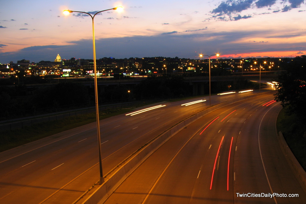 From an overpass from the EastSide neighborhood over Interstate 94. The sunset long gone. The State Capital building in the distance.