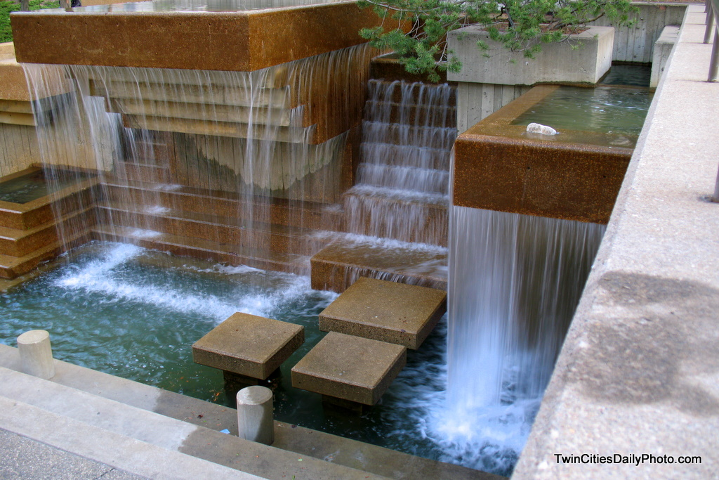 Just outside the door of Orchestra Hall, located in downtown Minneapolis is a park with plenty of water, pools, waterfalls, and artwork with water flowing out of them.