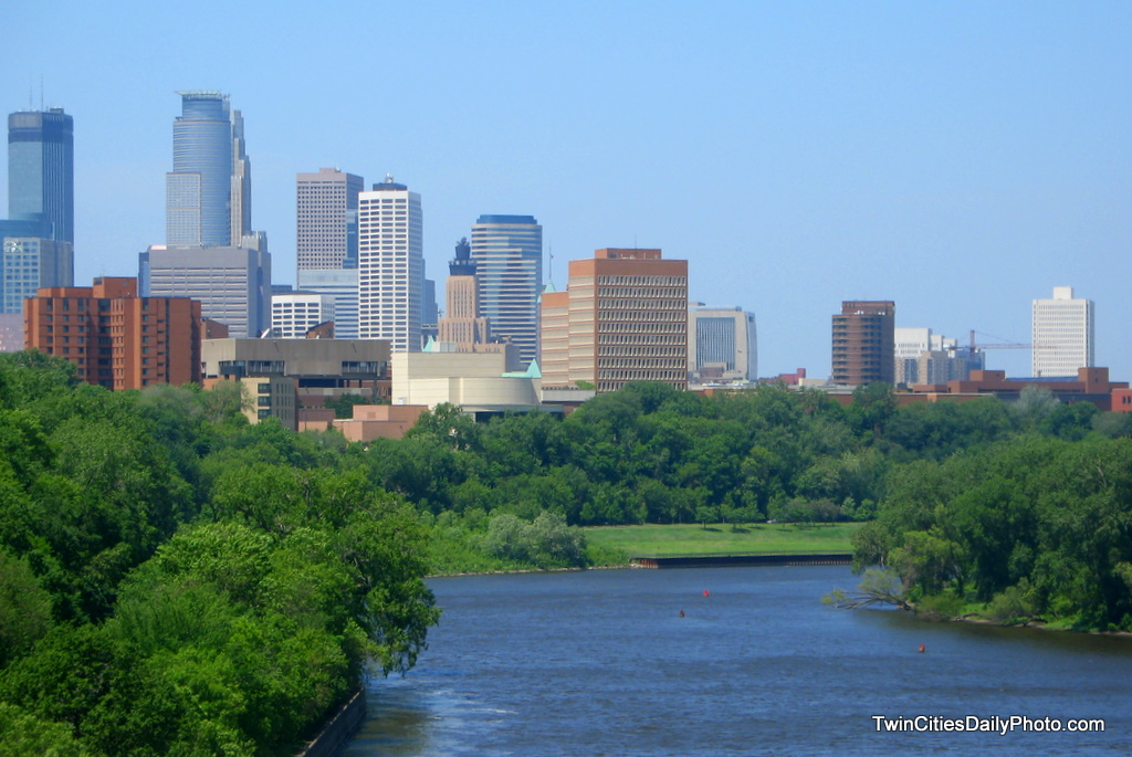 The skyline of downtown Minneapolis on a bright sunny day while crossing the Minnesota River.