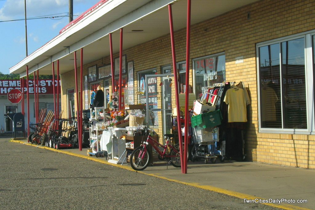 What happens when you have a hardware store next to a thrift store, with both store have items for sale sitting out on the sidewalk....well, it looks like a bunch of junk from this angle. I'm sort of laughing at the photo because there are actually three store entrance doors among all of the goods for sale.