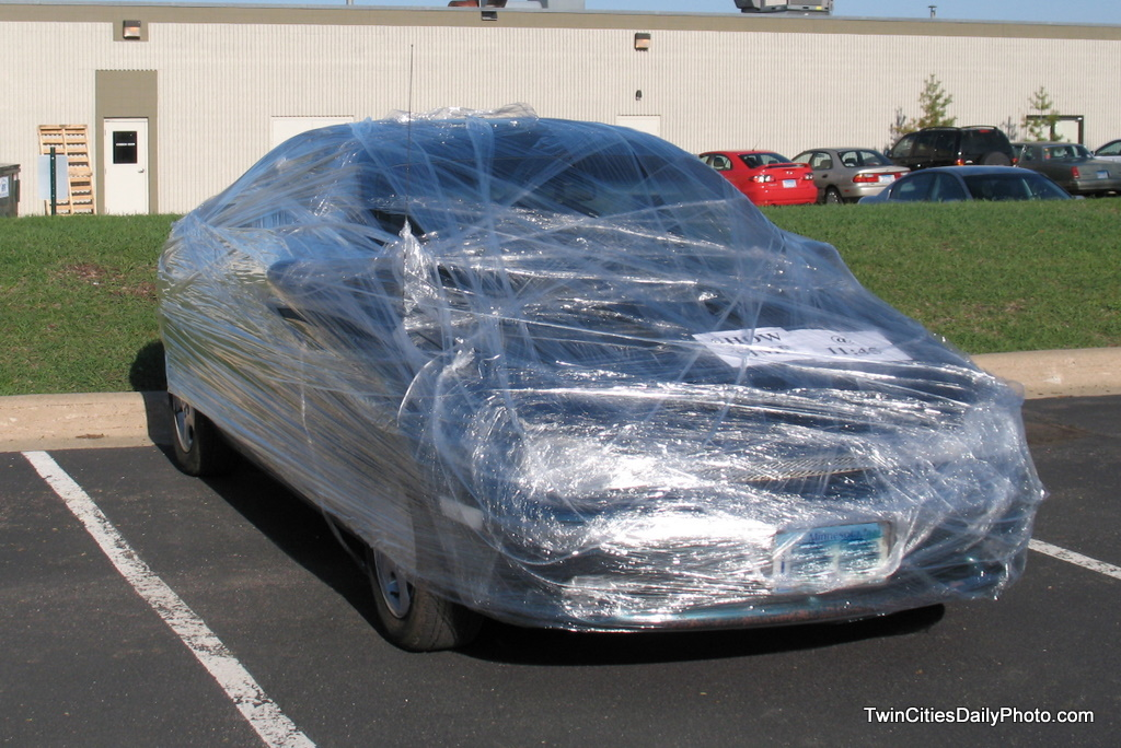 A practical joke was played on a co-worker, they jokers shrink wrapped a vehicle with plastic wrap.