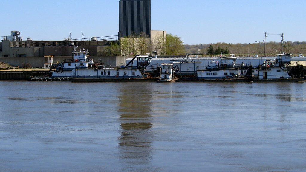 Tugboats lined up along shore of the Mississippi River near downtown St Paul.