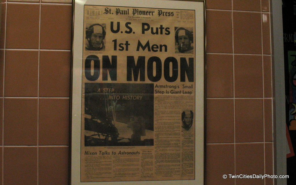 I was walking through Armstrong Elementary, named after Neil Armstrong, first man to set foot on the moon....when I noticed a copy of the St Paul Pioneer Press framed and hanging on the wall. It is indeed a genuine newspaper, you can see the fold in the center of the paper.