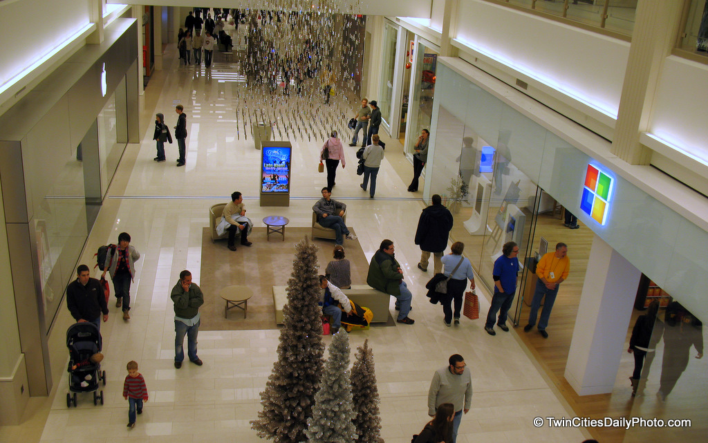 If you look closely at this photo, on the left side of the hallway, above the store entrance is the Apple logo. The logo above the store on the right side of the hallway belongs to Microsoft.