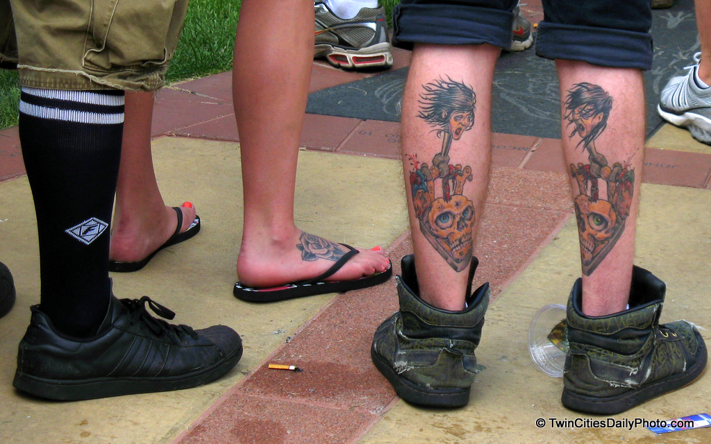 The tattooed legs caught my eye initially, but take another look....which is more shocking, the tattooed legs or the legs wearing shorts and over the calf socks? I mean really?