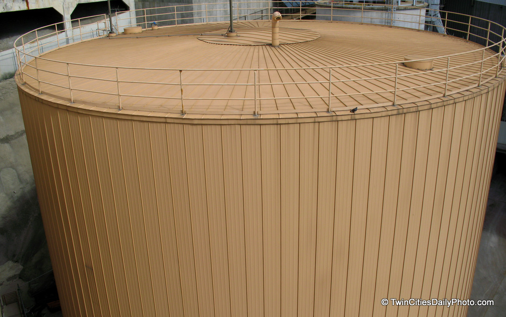 This silo is a storage bin that holds up to 1000 pounds of wood chips. Which is the amount the District Energy plant burns in one day. The clean energy power plant is used to create electricity, heating, and cooling for the St Paul downtown and nearby areas.
