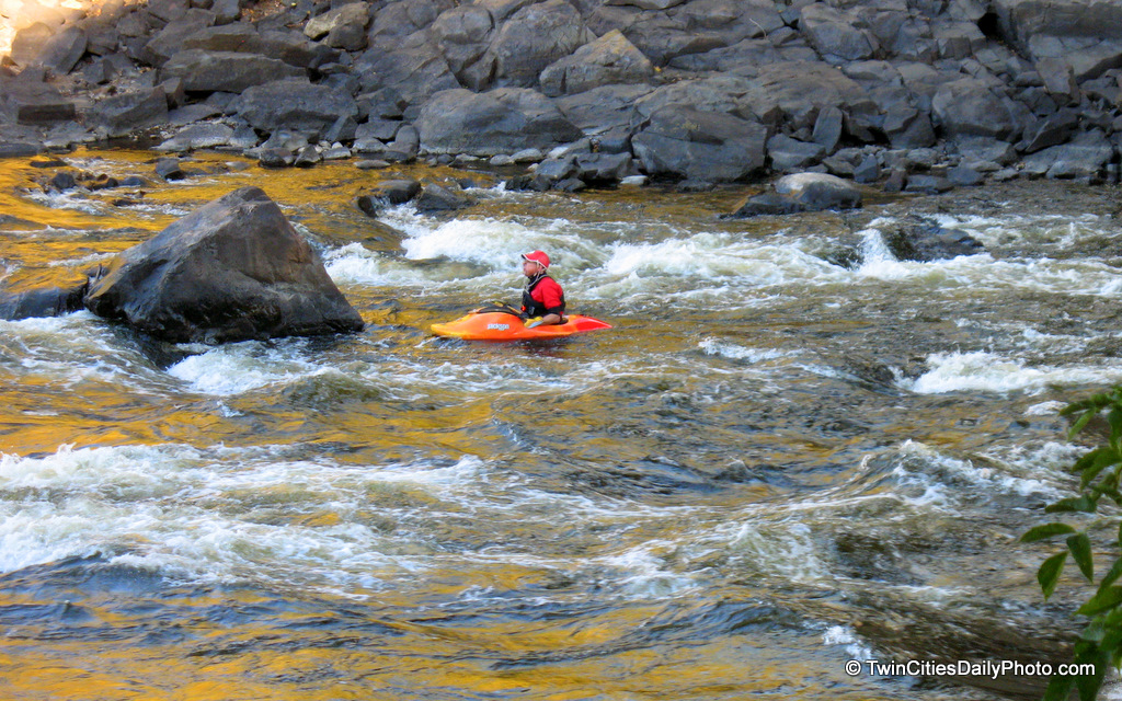 He was taking a break of fighting the current behind the large boulder. What is he sitting in, I'm not sure what this is exactly. It's way too small to be a kayak, unless this is a mini version of it.